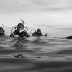 A nice moody shot of our happy divers!! Look at that flat water...